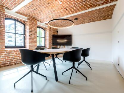 Din conference table with barrel shaped linoleum tabletop, design & planning: Spaceworks GmbH, photographer: Joachim Wagner